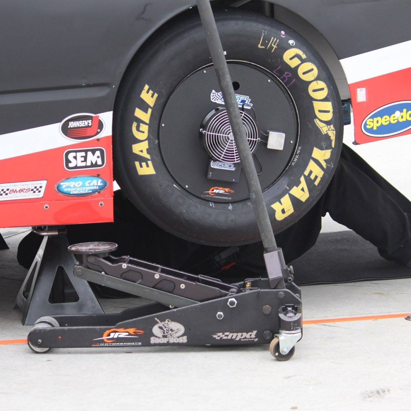 A Wireless Wheel Chill in use on a racecar that is being worked on